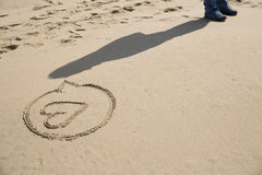 Escrita na areia na praia Foto de Stock