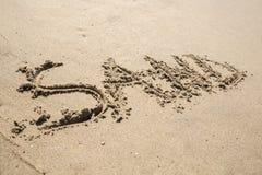 Escrita na areia na praia Fotos de Stock