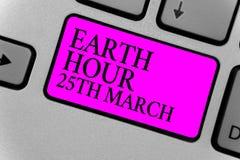 Escrita texto escrita terra hora o 25 de março O compromisso do símbolo do significado do conceito ao planeta organizou o computa Imagem de Stock