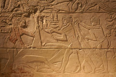 Escritas antigas velhas de Egipto na pedra fotografia de stock