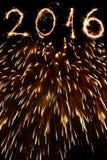 2016 escrito com fogos-de-artifício como um fundo Imagens de Stock Royalty Free