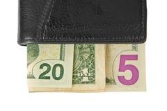 2015 escrito com notas de dólar em uma carteira Imagens de Stock