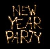 Escrito con el fuego artificial de la bengala: Texto del partido del Año Nuevo Imagen de archivo libre de regalías