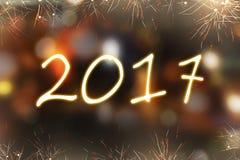 2017 escrito con el fuego artificial de la chispa Fotos de archivo
