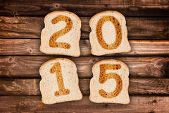 2015 escrito em fatias de pão brindadas Imagens de Stock Royalty Free