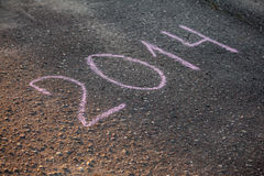 2014 escrito en el asfalto Fotos de archivo