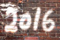 2016 escrito en a en la pared de ladrillo Foto de archivo libre de regalías