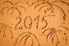 2015 escrito en la arena Foto de archivo libre de regalías