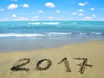 Escrito 2017 en la playa Fotografía de archivo