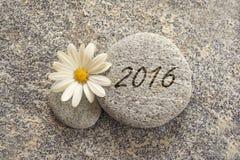 2016 escrito en un fondo de piedra Imagen de archivo libre de regalías