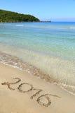 2016 escrito la playa arenosa Imagen de archivo libre de regalías