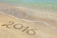 2016 escrito la playa arenosa Foto de archivo libre de regalías