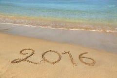 2016 escrito la playa arenosa Imagenes de archivo