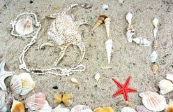 2014 escrito por las cáscaras del mar Foto de archivo libre de regalías