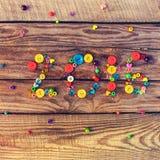 2016 escrito por los botones y las gotas en fondo de madera Fotografía de archivo libre de regalías