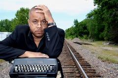 Escritor nas trilhas Imagem de Stock Royalty Free