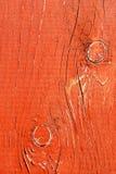 Escritorio de madera pintado en rojo Foto de archivo libre de regalías