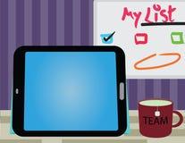 Escritorio de oficina con la tableta Fotos de archivo libres de regalías