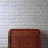 Escritorio en el ladrillo blanco Fotografía de archivo libre de regalías