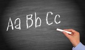 Escritura ABC en la pizarra o la pizarra Foto de archivo