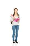 Escritura adolescente de la mujer con el lápiz enorme Foto de archivo