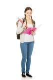 Escritura adolescente de la mujer con el lápiz enorme Imagen de archivo
