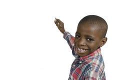 Escritura africana del muchacho con el lápiz, espacio de la copia libre Imagen de archivo
