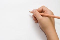Escritura aislada de la mano del niño Foto de archivo libre de regalías