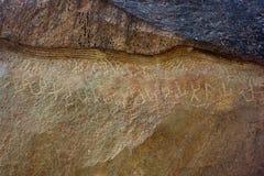 Escritura antigua perdida tallada en piedra imagen de archivo