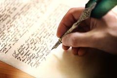 Escritura con la pluma de canilla Foto de archivo libre de regalías