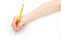 Escritura con un lápiz Foto de archivo libre de regalías