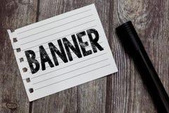 Escritura conceptual de la mano que muestra la bandera El lema o el diseño largo del transporte del paño de la tira del texto de  fotos de archivo libres de regalías
