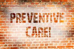 Escritura conceptual de la mano que muestra cuidado preventivo La diagnosis de exhibición de la prevención de la salud de la foto imagen de archivo