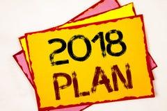 Escritura conceptual de la mano que muestra el plan 2018 Metas desafiadoras de exhibición de las ideas de la foto del negocio par Foto de archivo libre de regalías