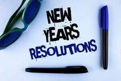 Escritura conceptual de la mano que muestra las resoluciones de los Años Nuevos Los objetivos de exhibición de las metas de la fo Fotografía de archivo libre de regalías