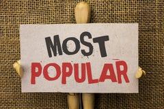 Escritura conceptual de la mano que muestra la más popular Producto o artista preferido 1r del bestseller del grado del top del t Foto de archivo