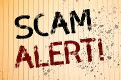 Escritura conceptual de la mano que muestra a Scam llamada de motivación alerta Fotos del negocio que muestran la advertencia de  Fotografía de archivo
