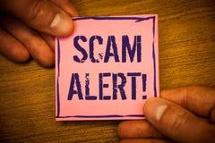 Escritura conceptual de la mano que muestra a Scam llamada de motivación alerta Las fotos del negocio mandan un SMS a la adverten Imagen de archivo libre de regalías