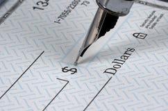Escritura de cheques Foto de archivo