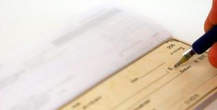 Escritura de cheques Fotos de archivo