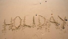 Escritura de la arena - Holoday fotografía de archivo