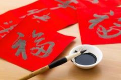 Escritura de la caligrafía china por Año Nuevo chino, palabra Fu, malo Imagen de archivo libre de regalías