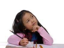 Escritura de la chica joven Imagenes de archivo