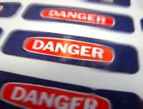 Escritura de la etiqueta amonestadora del peligro del peligro Imagen de archivo libre de regalías