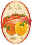 Escritura de la etiqueta con dos pimientas y tomates. Fotos de archivo