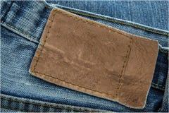 Escritura de la etiqueta de cuero en blanco de los pantalones vaqueros Fotografía de archivo