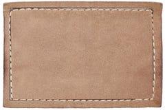 Escritura de la etiqueta de cuero en blanco de los pantalones vaqueros en blanco Foto de archivo libre de regalías
