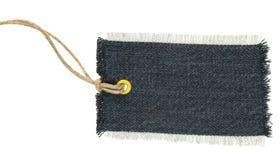 Escritura de la etiqueta de la materia textil Imagenes de archivo