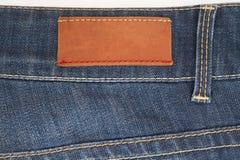 Escritura de la etiqueta de los pantalones vaqueros Foto de archivo libre de regalías
