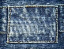 Escritura de la etiqueta de los pantalones vaqueros Imagenes de archivo